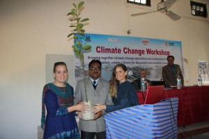 Vice-Principal of M C College was presented with a choto gach or small tree by members of the organizing team