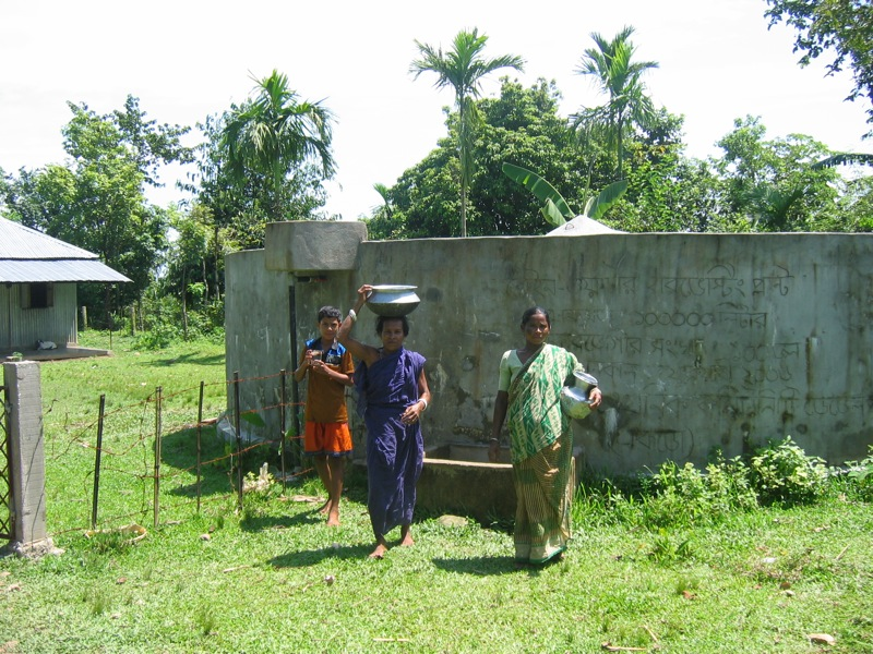Indigenous women are collecting water from Rain water harvesting plant