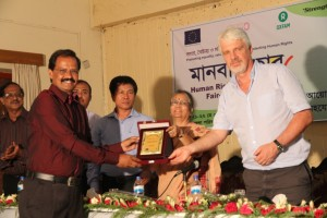 Mr. Ikramul Kabir from Somoy TV Sylhet office is receiving his Human Rights journalism award from our guests